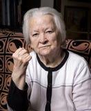 Dame âgée dans le geste fâché Photographie stock