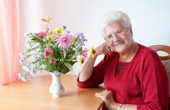 Dame âgée heureuse Photographie stock