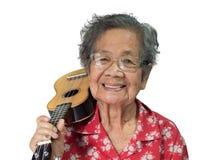 Dame âgée jouant l'ukulélé Image libre de droits