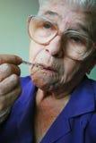 Dame âgée malade   photographie stock