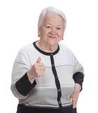 Dame âgée montrant le signe correct Photo stock