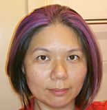 Dame asiatique avec le point culminant pourpre Images libres de droits