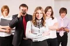 Dame attirante d'affaires et son équipe Photographie stock