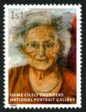 Dame Cicely Saunders UK Postage Stamp. GREAT BRITAIN - CIRCA 2006: A used postage stamp from the UK, depicting an image of a painting of historic nurse Dame Royalty Free Stock Photo