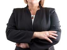 Dame d'affaires sur le blanc avec des bras croisés Photo stock