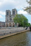 Dame de Paris Cathedral and Seine River embankment Royalty Free Stock Photos