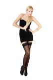 Dame in der schwarzen Kleidstellung Stockbild