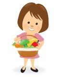 Dame, die Frucht- und Veggiekorb hält Stockbild