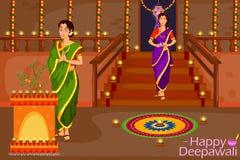 Dame die met diya Diwali-festival van India vieren royalty-vrije illustratie