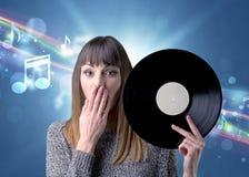 Dame die vinylverslag houden royalty-vrije stock foto
