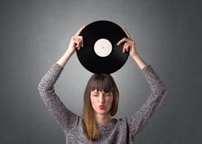 Dame die vinylverslag houden royalty-vrije stock afbeeldingen