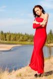 Dame in een rode kleding royalty-vrije stock afbeelding