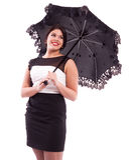 Dame im Abendkleid mit Regenschirm Stockbild