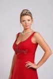 Dame im Rot Stockbild