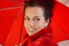Dame im Rot Stockfotos