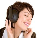 Dame Listening aan Muziek met Hoofdtelefoons stock afbeelding