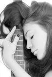 Dame met een gitaar Stock Foto's