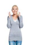 Dame mit den Fingern gekreuzt Stockbild