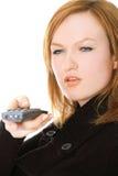 Dame mit einem Fernsteuerungs Stockfotos