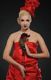 Dame mit einer Rose Stockfotos