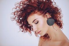 Dame mit Ohrringen Stockbilder