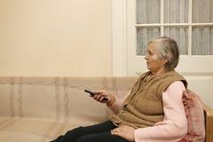 Dame pluse âgé avec à télécommande Photos libres de droits