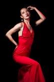Dame in rode avondjurk Stock Afbeeldingen