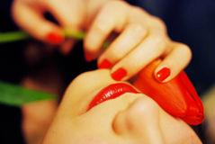 Dame in rood Stock Foto