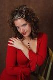 Dame sensuelle en rouge Photo stock