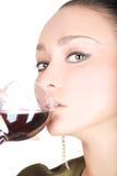 Dame sexy avec une glace de vin rouge Photographie stock