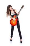 Dame sexy jouant dans la guitare d'isolement sur le blanc Image stock