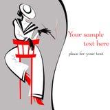 Dame Stranger auf einem roten Stuhl Stockbilder