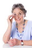 Dame supérieure heureuse - une femme plus âgée d'isolement sur le fond blanc Photos stock