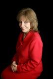 Dame in Vriendschappelijk Rood - stock fotografie