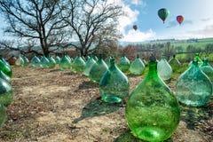 Damejeannar och varmluftsballonger Arkivfoto