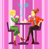 Damer i ett kafé Royaltyfri Foto
