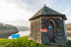 DAMFLASK, ENGLAND - FEBRUARY 23RD, 2019: A lone Yorkshire Water building sits at the front of the Damflask Reservoir stock images