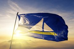 Damietta Governorate of Egypt flag textile cloth fabric waving on the top sunrise mist fog. Beautiful royalty free stock images