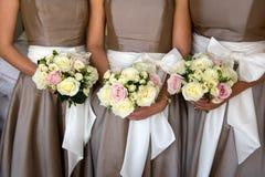 Damigelle d'onore con i fiori Fotografia Stock