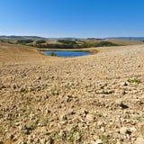 Damm för bevattning i Italien Royaltyfria Bilder
