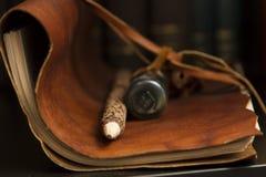 Dammig dagbok och blyertspenna fotografering för bildbyråer