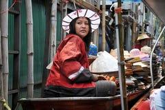 Damnern Saduak Floating Market, Thailand. Thai woman selling hats Damnern Saduak Floating Market, Thailand Stock Photo