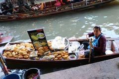 Durian and mango with sticky rice seller on the boat in the canal at Damnoen Saduak floating market royalty free stock image