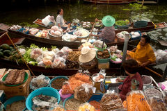 Damnuan Saduak floating market in Middle of Thailand. Royalty Free Stock Photo