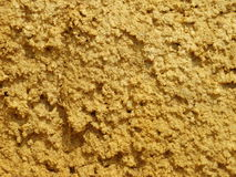 Damp sand with yellow-orange colour. Sand found in the neighbourhood of the castle in Chinon Stock Photos