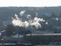 Dampf über Stadt Stockfotos