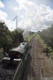 Dampf-Lokomotive in der englischen Landschaft Stockfotos