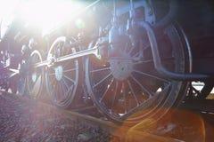 Dampf-Lokomotive-Sun-Aufflackern Stockfoto