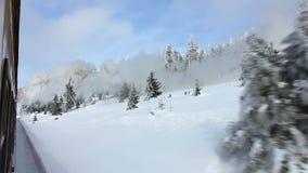Dampfzug in der winterlichen Landschaft stock footage