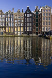 Damrak, Amsterdam. Buildings on the Damrak canal, Amsterdam Royalty Free Stock Photo